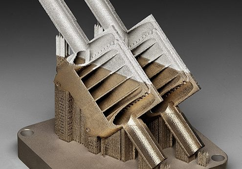 Additive manufacturing of two metals in one product